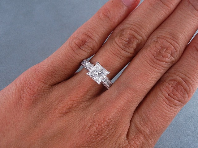 Princess cut solitaire engagement rings on hand