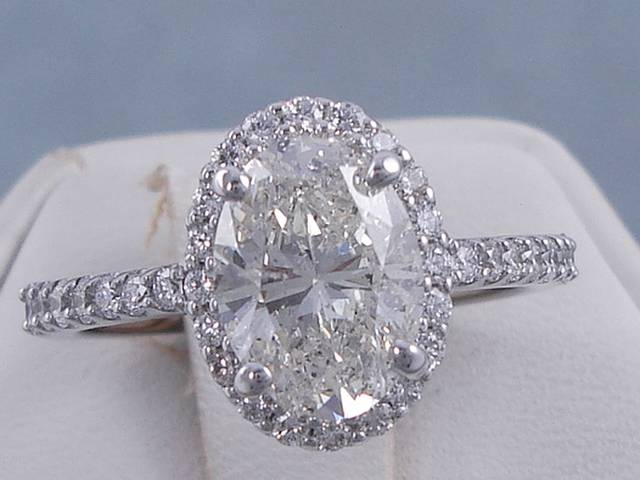 2 19 CARATS TW OVAL CUT DIAMOND ENGAGEMENT RING H SI2
