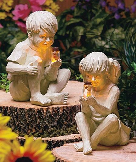 kids boy or girl children with solar fireflies lighted