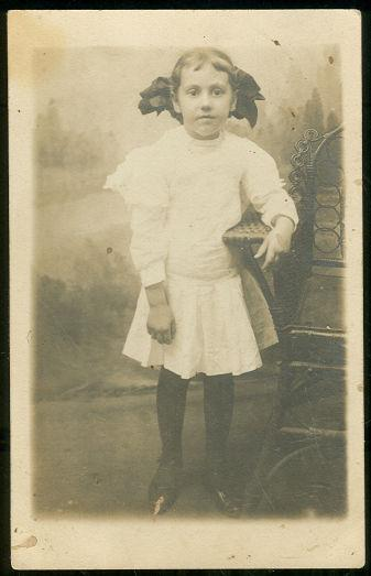 REAL PHOTO POSTCARD OF LITTLE GIRL IN WHITE WITH BIG BOW, Postcard