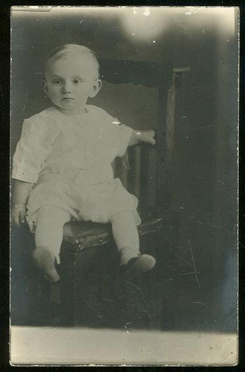 REAL PHOTO POSTCARD OF BABY BOY SITTING IN CHAIR, Postcard