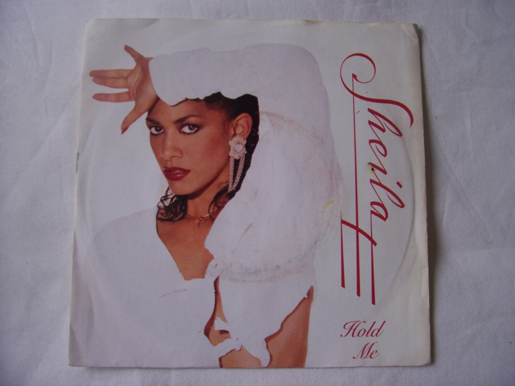 SHEILA E - Hold Me/the World Is High