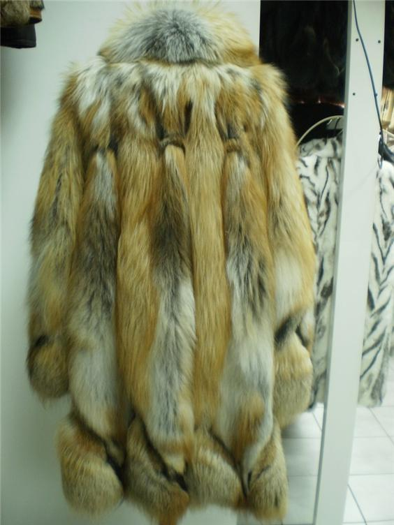 red fox fur coat in our fur store rear view