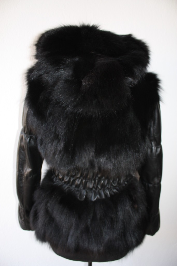 black fox fur jacket with hood , leather waist and sleeves rear view