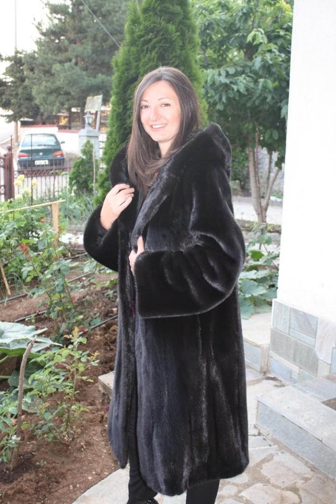 image of balck mink fur coat full length side view