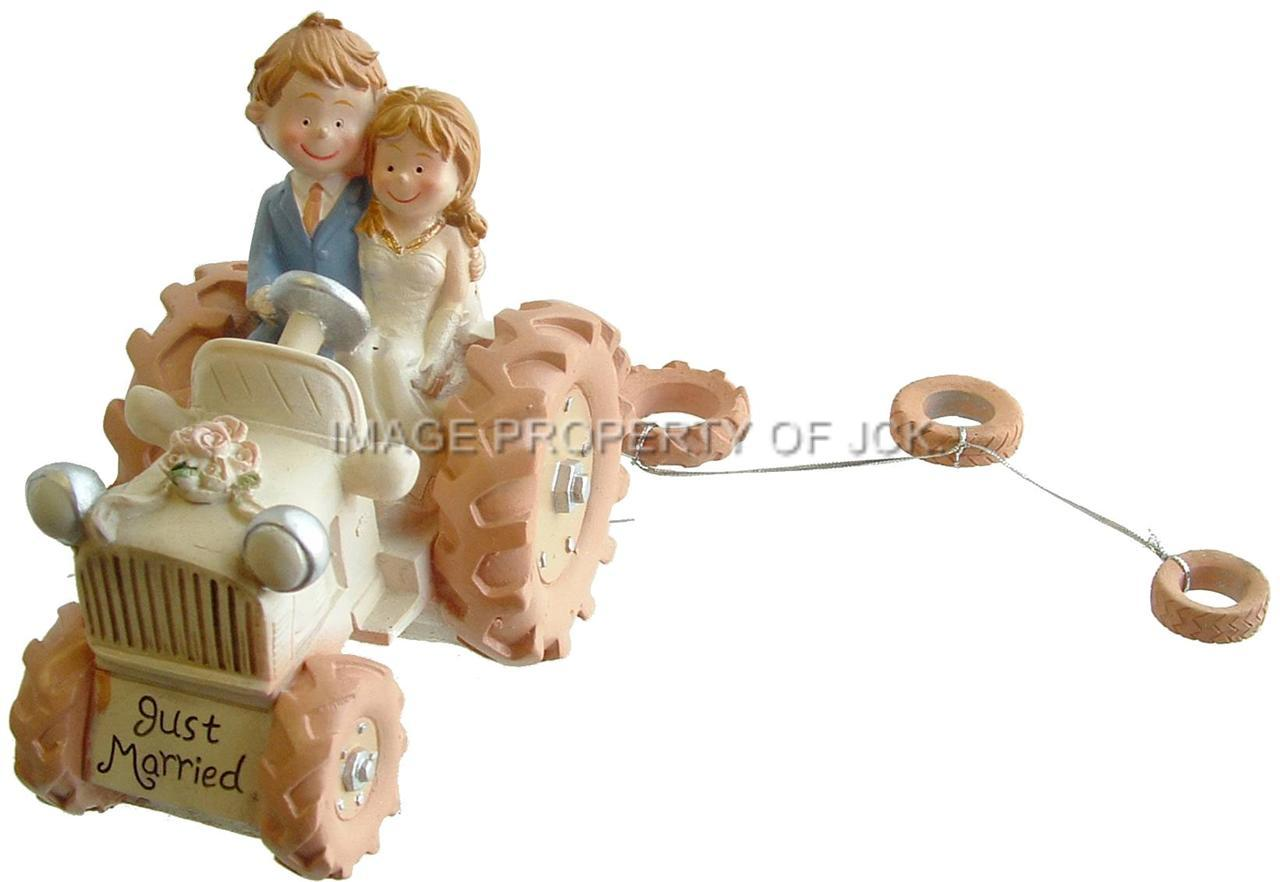 BRIDE AND & GROOM ON A CREAM IVORY TRACTOR WEDDING CAKE