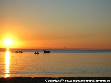 Sunrise over the ship wracks on Moreton Island