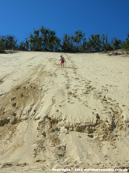 Finding a dune to slide is not difficult on Moreton Island