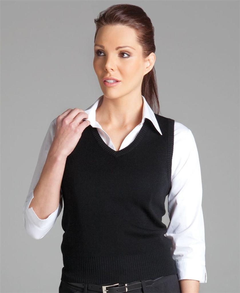 Great black knit vest with buttons going down the front. Has a high low detail and falls at the waist. Will look great with a long sleeve or a short sleeve top and slacks or jeans.