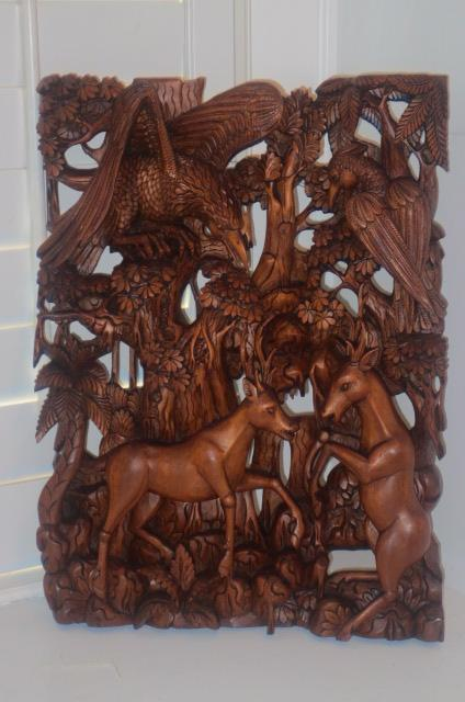 Vintage intricate bali wood carving birds trees antelope