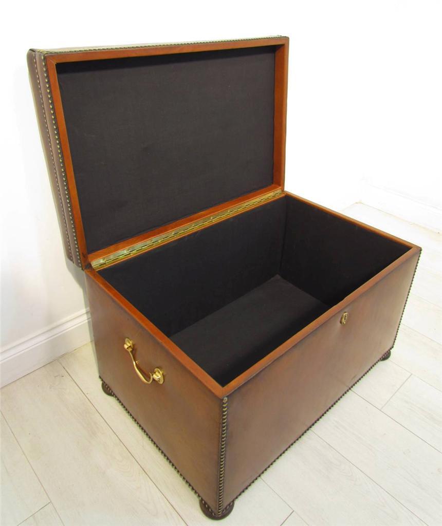 an antique style leather chestnut brown ottoman storage