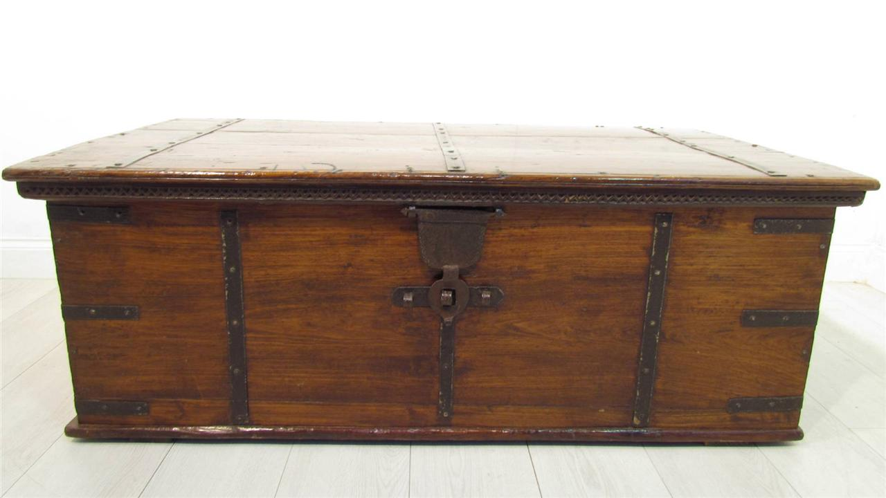 A large antique 18th c iron bound teak coffer trunk coffee Trunk coffee table