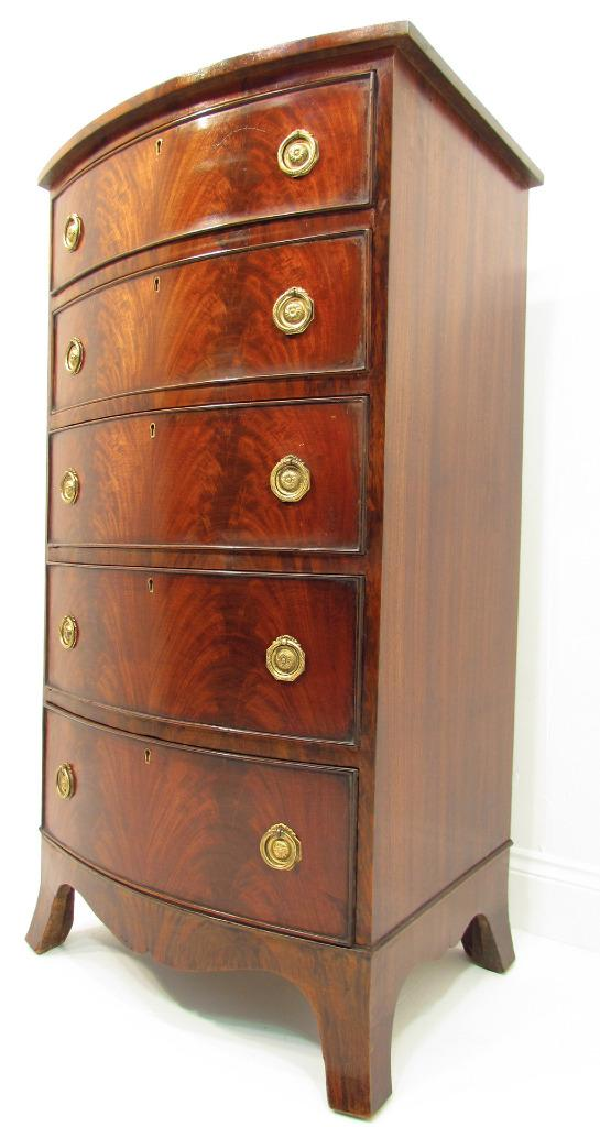 an antique tall and narrow flamed bow front mahogany chest of drawers. Black Bedroom Furniture Sets. Home Design Ideas