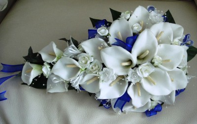 PACKAGE MADE WITH REAL TOUCH FOAM CALA LILLIES AND ROYAL BLUE RIBBON