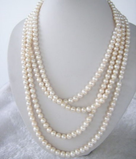 Stunning 120&quot.  7-8mm white salt water Pearls Necklace