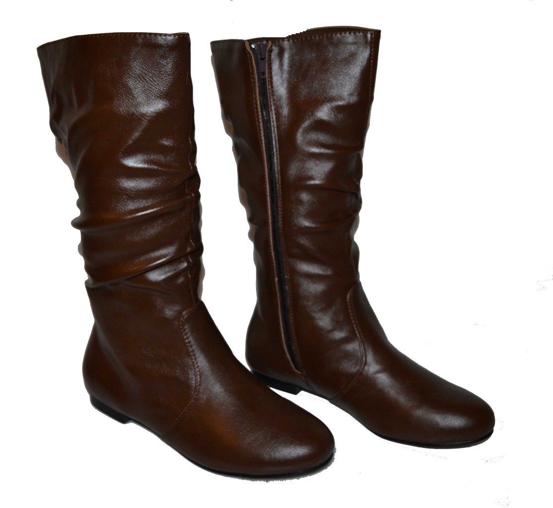 Luxury A Collection Of Womens Shoes This Collection Includes Four Pairs There Is A Pair Of Light Brown Barneys New York Leather, Low Boots That Are Made In Italy, A Pair Of Dark Brown Suede TODS Boots, A Pair Of Joan And David Flats That