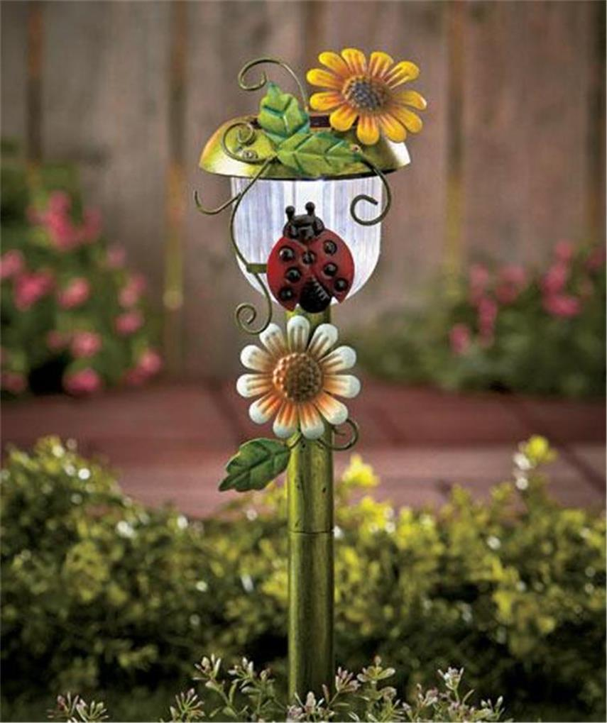 Decorative 3 d solar power auto on garden yard stake light for Decorative garden stakes