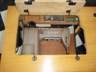 1950 singer sewing machine cabinet value