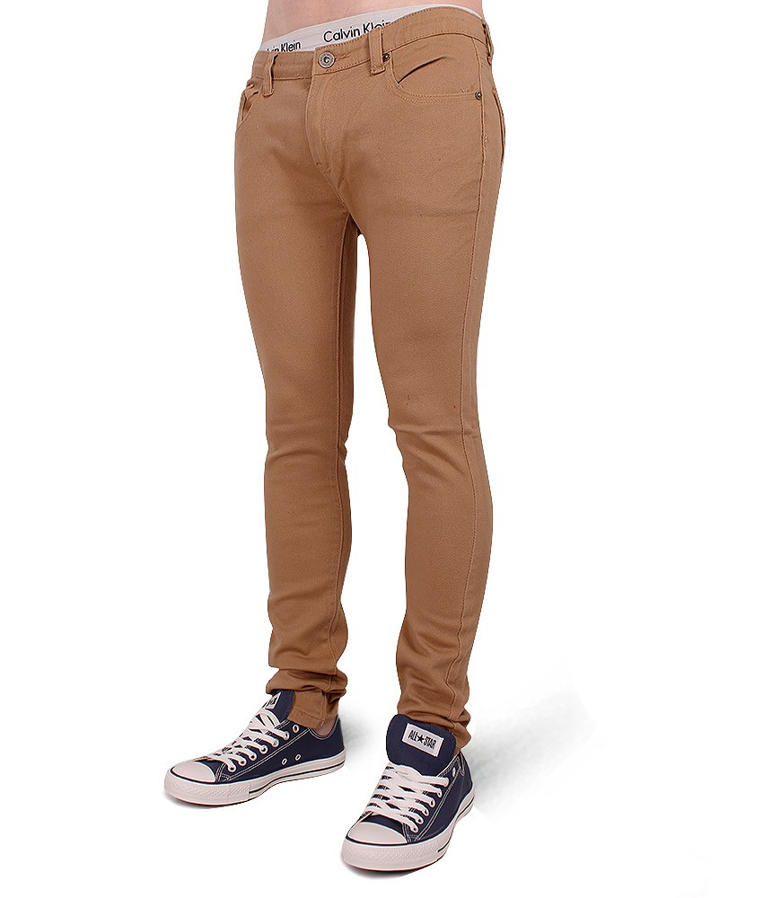 Men's skinny jeans should not be too tight, as there should be stretch and you should be able to move comfortably in them. Skinny jeans fit your legs, and narrow in around the calves more than straight jeans.