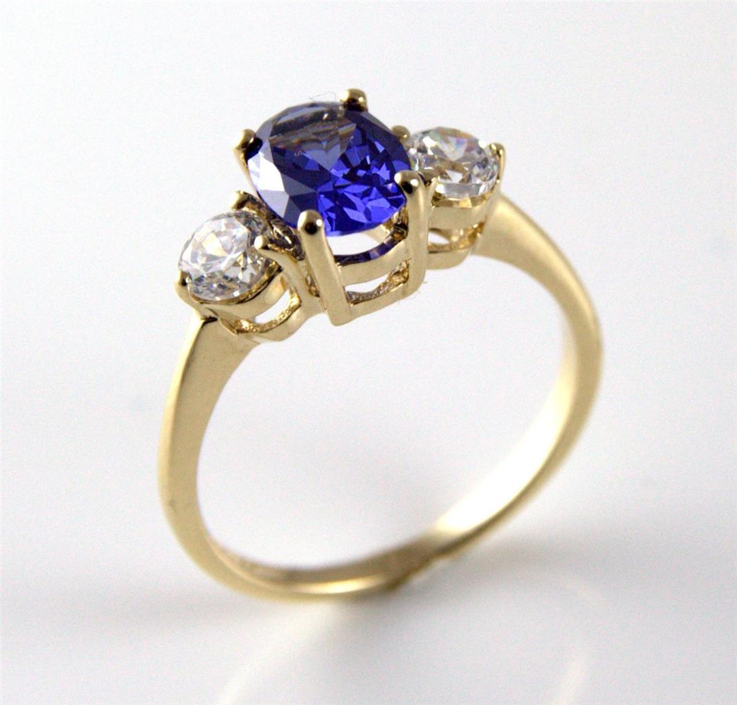 unique tanzanite trilogy ring 9ct gold