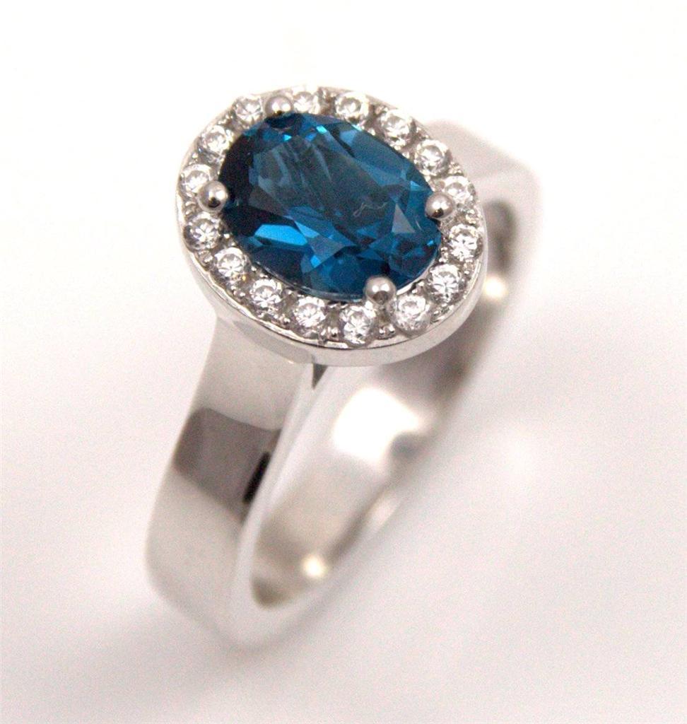 unique oval cut blue topaz halo rhodium platinum