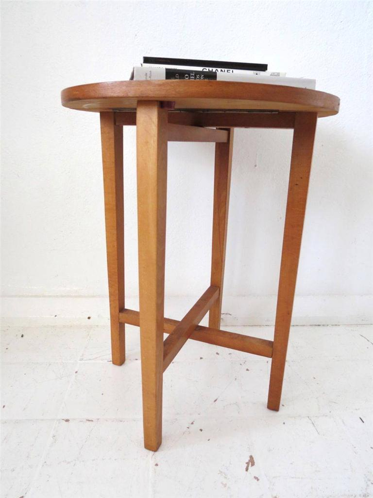 A Lovely Round Shape Side Table With Great Fold Up Option