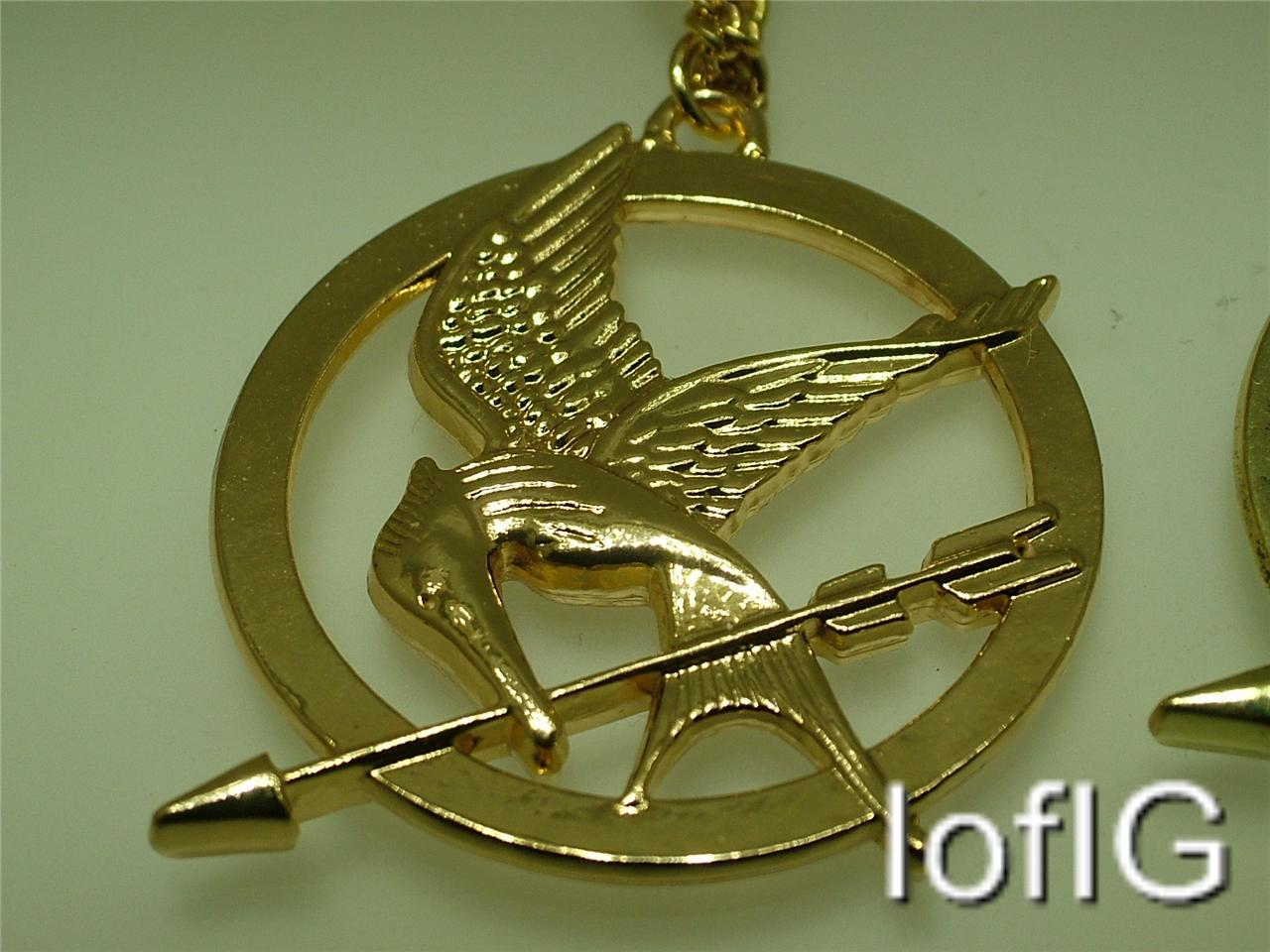 The hunger games mockingjay bird pendant long necklace gold the hunger games mockingjay bird pendant amp long mozeypictures Image collections