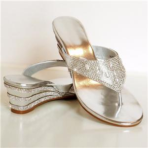 Ladies' wedge sandals are distinct in that they come with a slight graduated heel. Wedges offer a pleasant compromise between a high heel and a flat, marrying some of the height of the former with some of the stability of the latter.