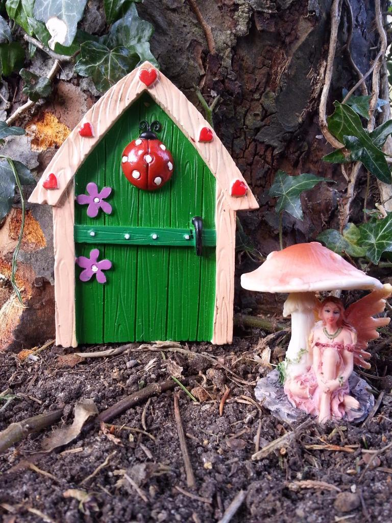magical fairy door garden ornament with mini faerie. Black Bedroom Furniture Sets. Home Design Ideas