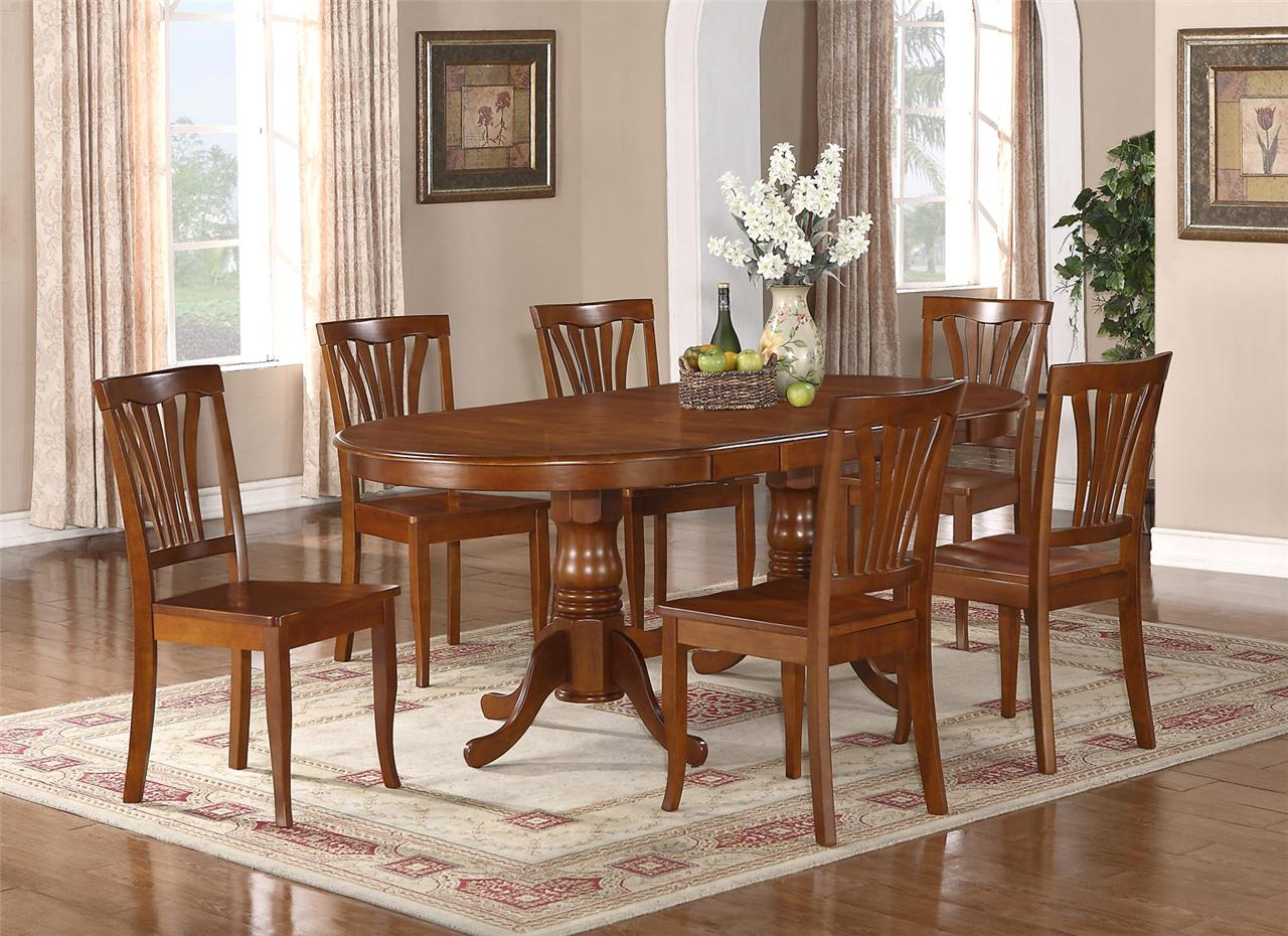 9pc oval newton dining room set with extension leaf table for Wooden dining room furniture