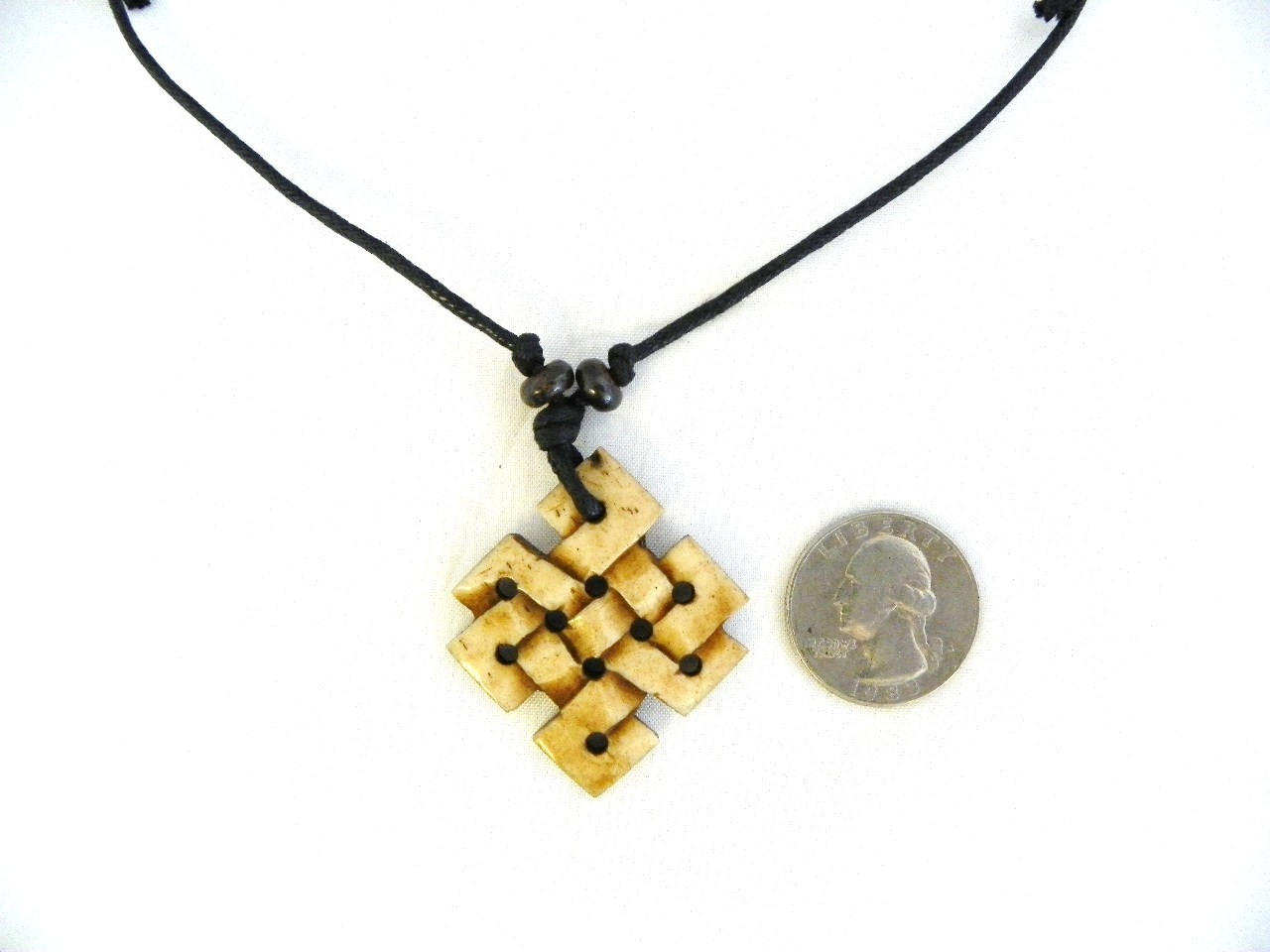 tibetan bone endless knot pendant necklace crafted in