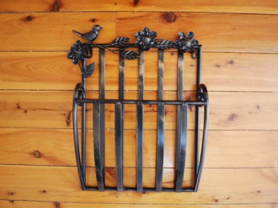 a french country style wall mounted metal magazine rack lovely detailed bird and country flower tails are pleasing to the eye well designed and nicely