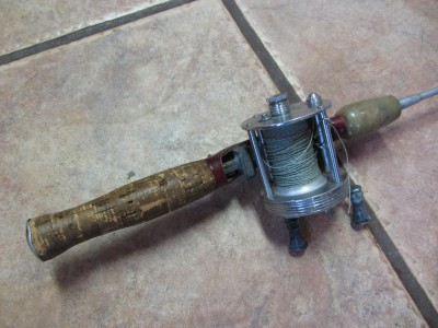 vintage higgins metal aluminum fishing pole reel old On antique metal fishing rods