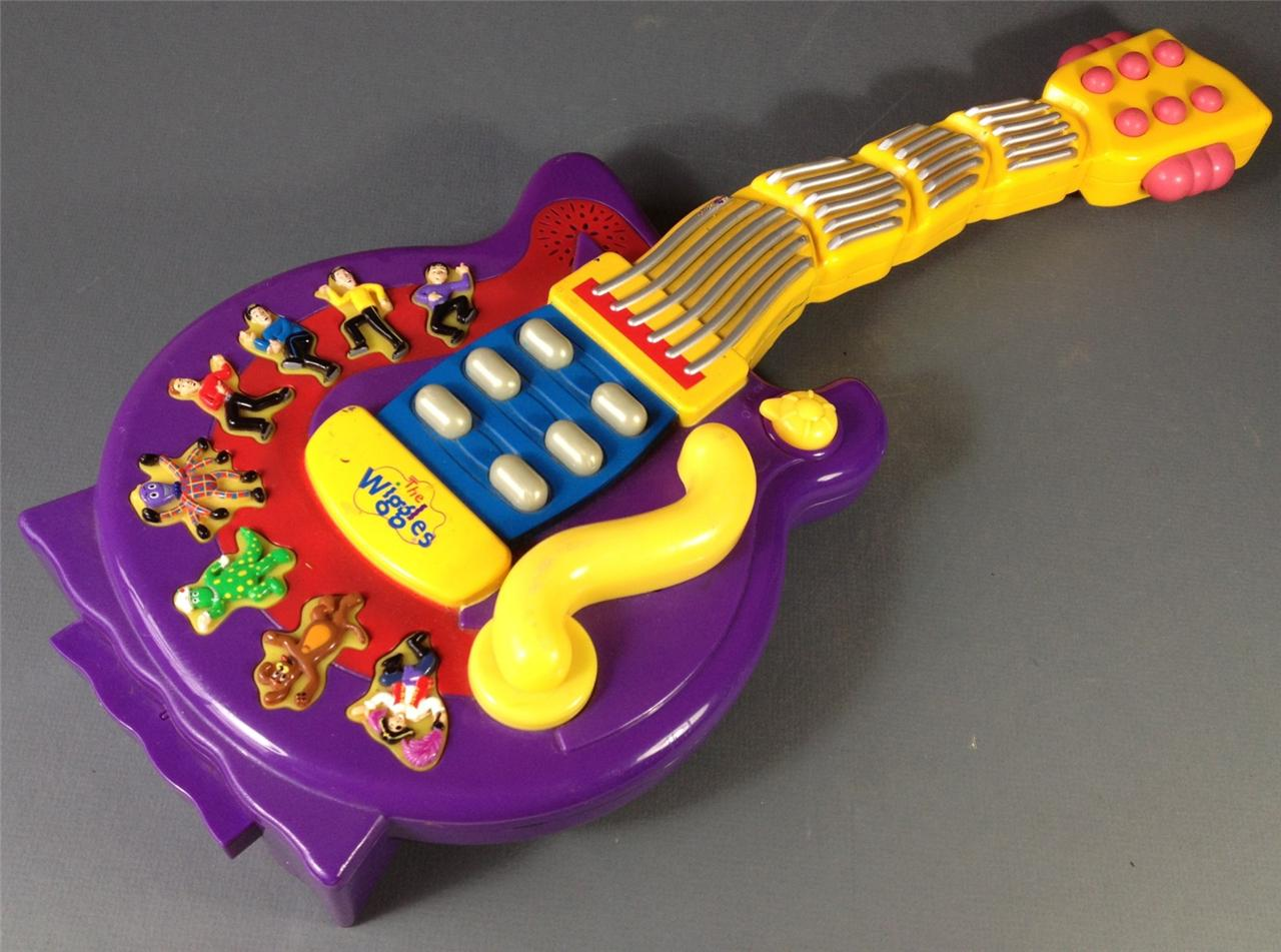 The Wiggles purple wiggly musical guitar works battery