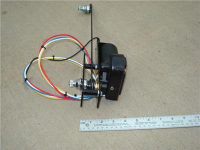 vacuum or electric windshield wiper motor. This unit is designed for