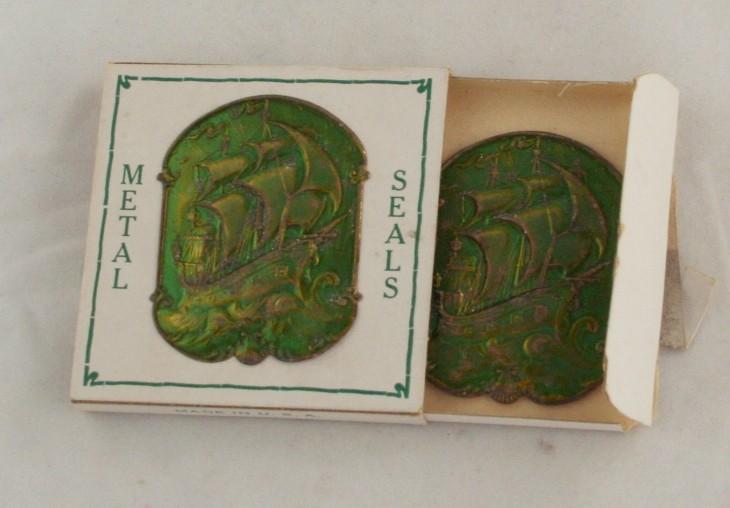 vintage sticker, metal embossed, seal, sailing ship