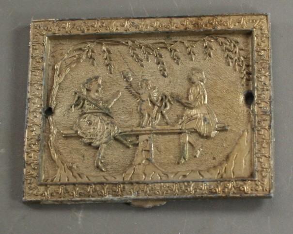 vintage plaque, bas relief, metal, cast metal, cupid, couple, see saw