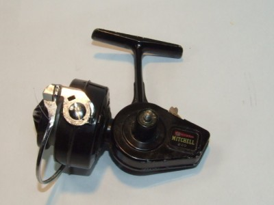 Vintage garcia mitchell 320 spinning reel made in france for Old mitchell fishing reels