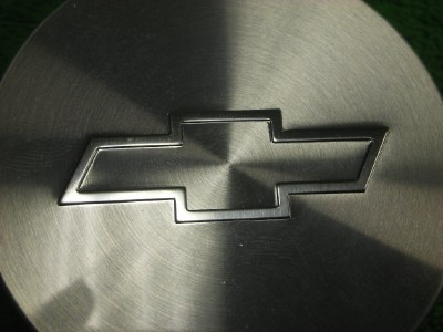 Find chevy center caps bowtie parts on ownstercom autos for 2002 buick rendezvous window clips