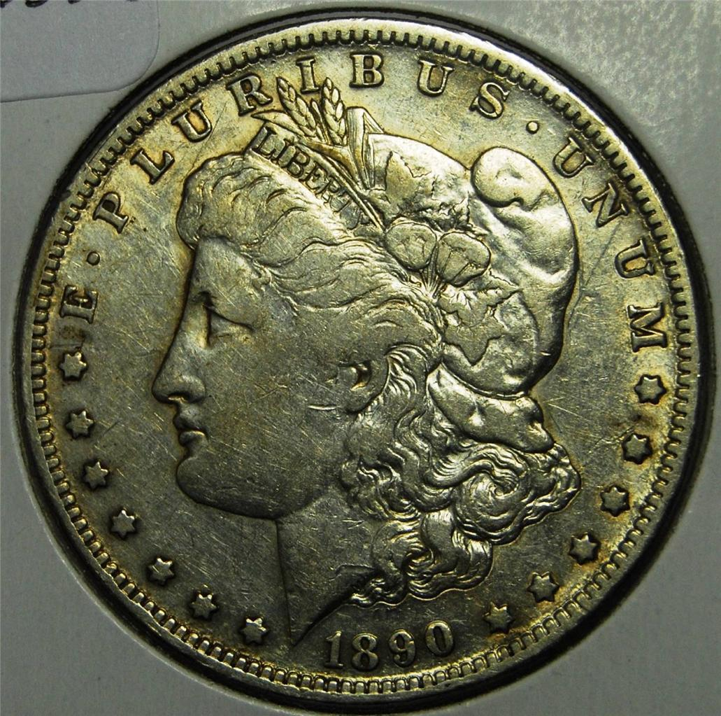 S Morgan US silver dollar - High Grade Not professionally Graded but believed to be an AU, as seen in photos. Shipped First Class USPS Shipped First Class USPS O $ Morgan silver dollar MS 64+ PL ICG certified.