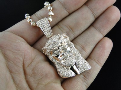 Rose gold sterling silver lab diamond mini jesus piece pendant the pendant is made is solid sterling silver stamped 925 each diamond is hand set in a seamless micro pave setting allowing the diamonds to reflect off aloadofball Image collections