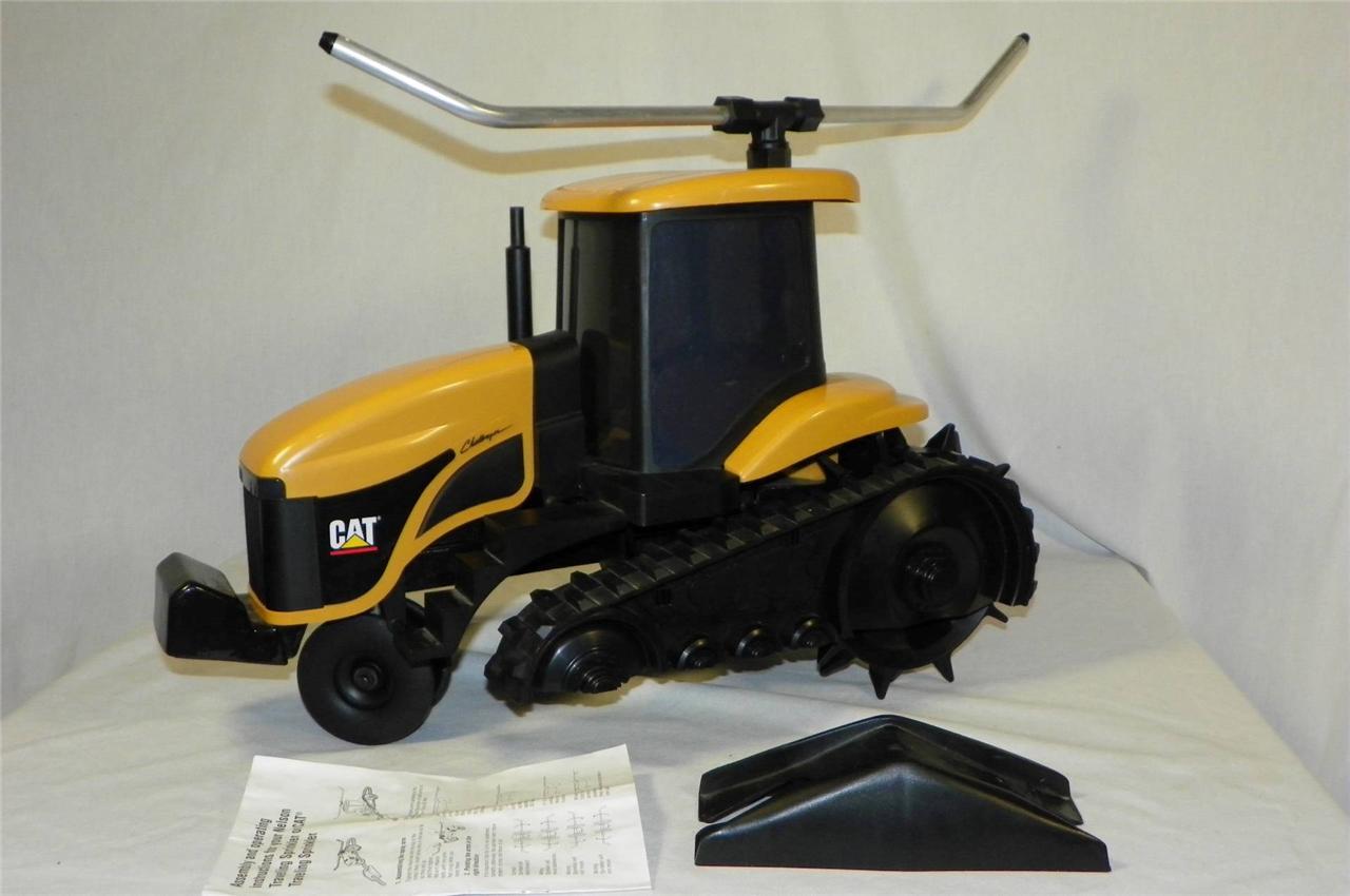 Traveling Lawn Sprinkler Tractor : Cat challenger tractor cast iron lawn sprinkler