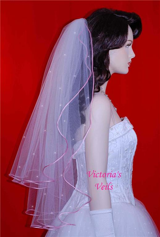 ivory wedding veil with pink ribbon trim <div align=