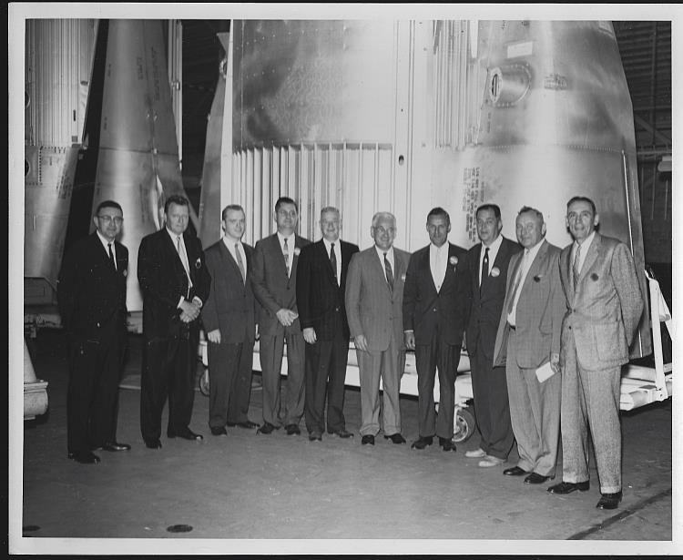 ORIGINAL PHOTOGRAPH OF LARGE GROUP OF MEN STANDING IN FRONT OF SATURN ENGINE, MARSHALL SPACE FLIGHT CENTER, Photograph