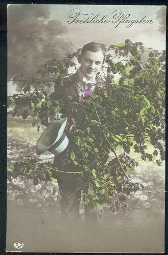 GERMAN POSTCARD OF MAN WITH FLOWERS FROHLICHE PFINGSTON, Postcard