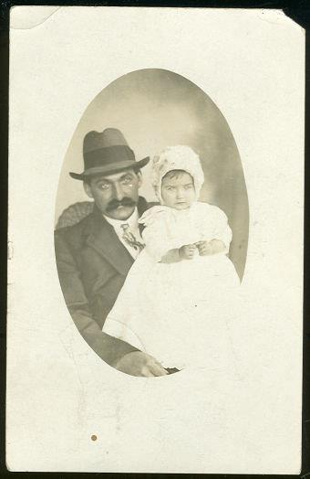 REAL PHOTO POSTCARD OF JAMES HOLDING THE BABY, Postcard