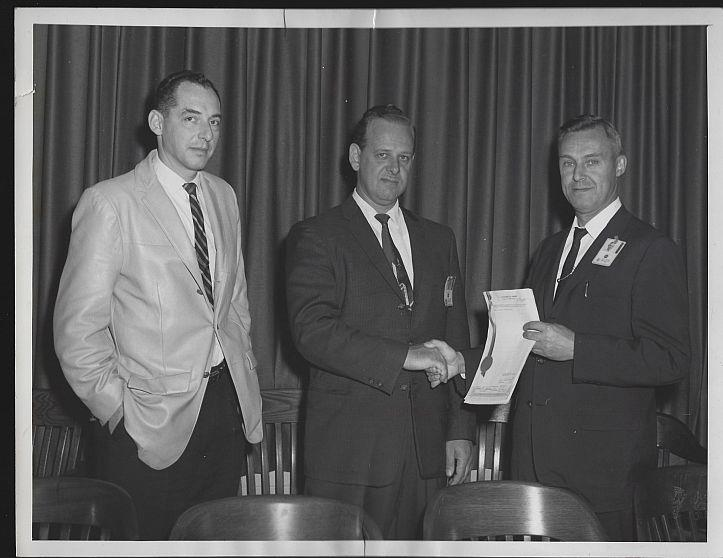 ORIGINAL PHOTOGRAPH OF PRESENTATION WITH THREE MEN, MARSHALL SPACE FLIGHT CENTER, Photograph