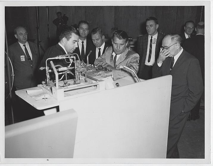 ORIGINAL PHOTOGRAPH OF WERNHER VON BRAUN AND OTHER MEN LOOKING AT SATURN ROCKET EQUIPMENT, MARSHALL SPACE FLIGHT CENTER, Photograph