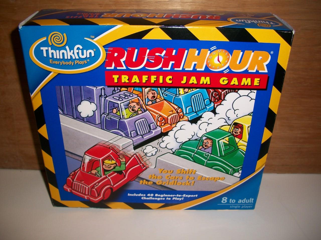 think fun rush hour traffic jam game original handheld traffic jam