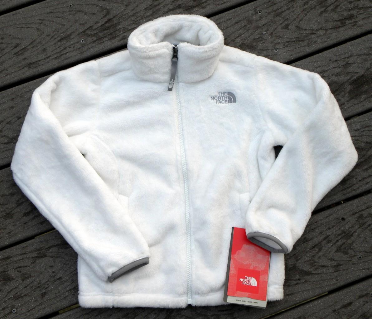 White fuzzy north face jacket